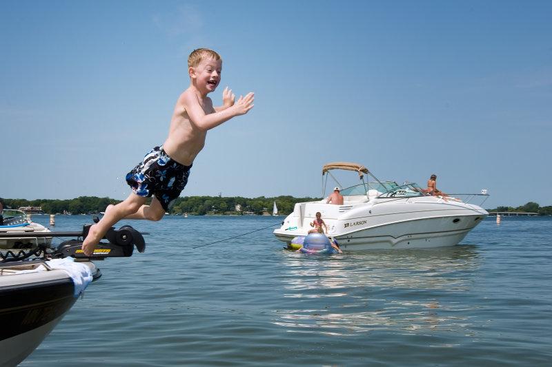 Ryan jumps off boat
