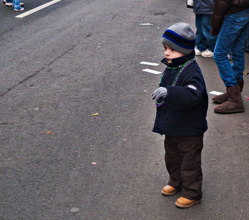 Boy watching parade