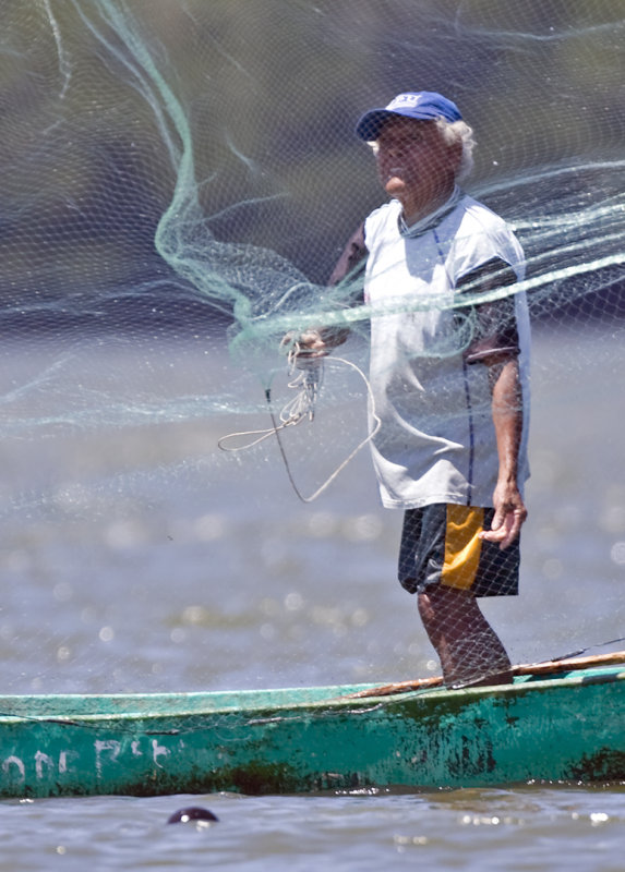 Fisherman Casting a Net
