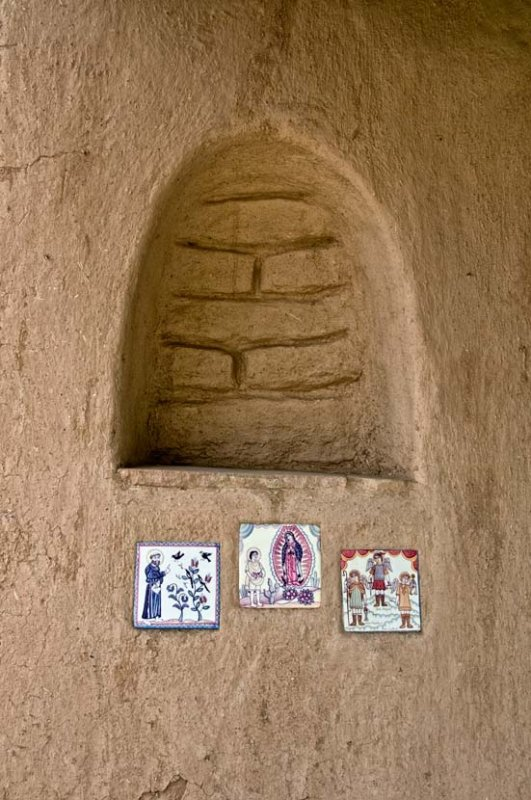 Church alcove in the thick adobe wall