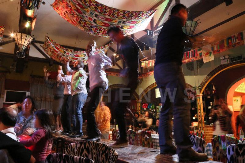 Dancing on table-top; At A Fun Ti in Beijing