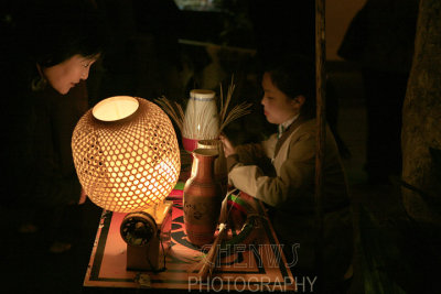 Bamboo basket lantern weaver, China