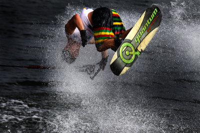 PUTRAJAYA, MALAYSIA - NOV 09: Aliaksei Zharnasek performs in the tricks event on the wakeboard at the Waterskiing and Wakeboard