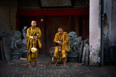 Siamese monks on the street