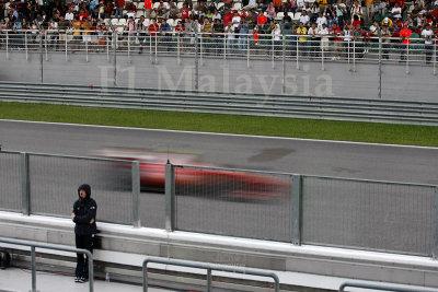 Ferrari blazing past the grandstand