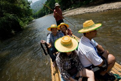 A bamboo raft fide down river