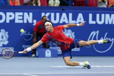 Singles final : Juan Monaco (Argentina) dives