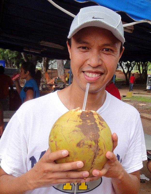 Enjoying a Coconut