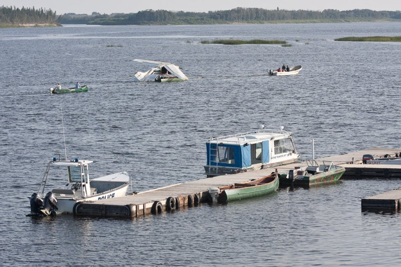 Recovered Cessna being towed upriver