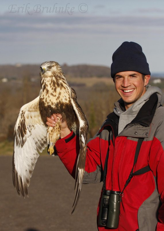Cameron holding the Rough-legged Hawk