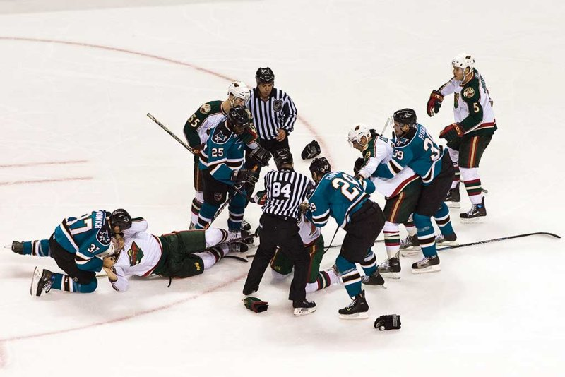 Scrum caused by Ryane Clowe on Cal Clutterbuck after a check to Dan Boyle