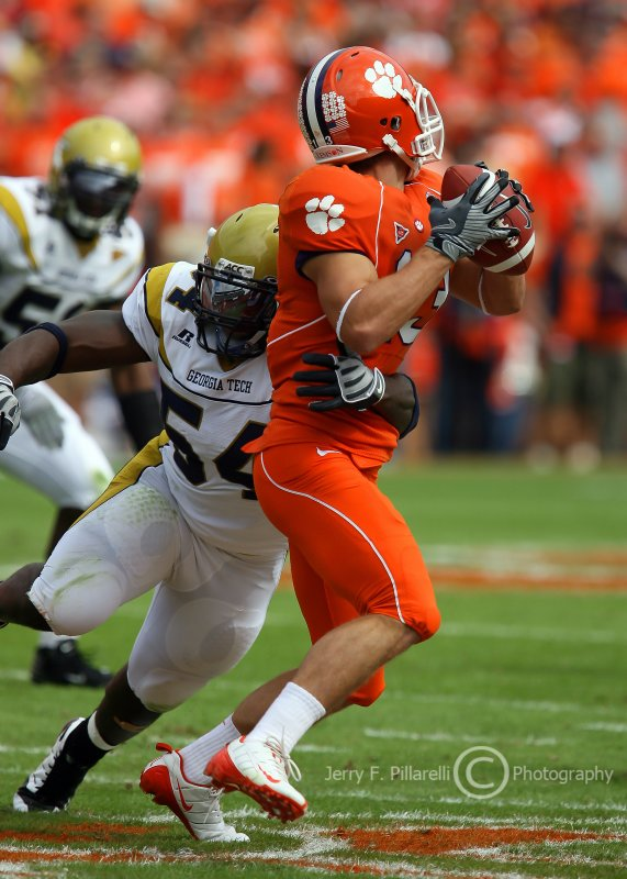 Jackets LB Cedric Griffin sack Tigers WR Tyler Grisham as he attempt to pass