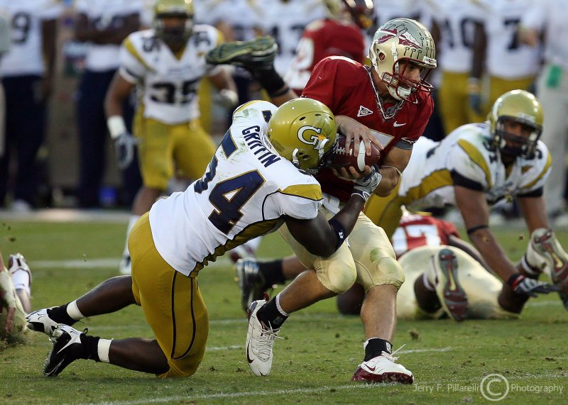 Georgia Tech LB Griffin tries to pry the ball away from Florida St. QB Ponder as he gets the sack