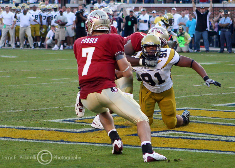Jackets DE Morgan gets taken to the ground as he pursues Noles QB Ponder in the FSU end zone