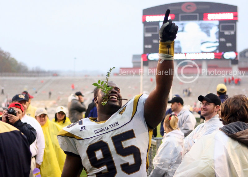 Yellow Jackets DT Richard shows the fans who is number one in the state