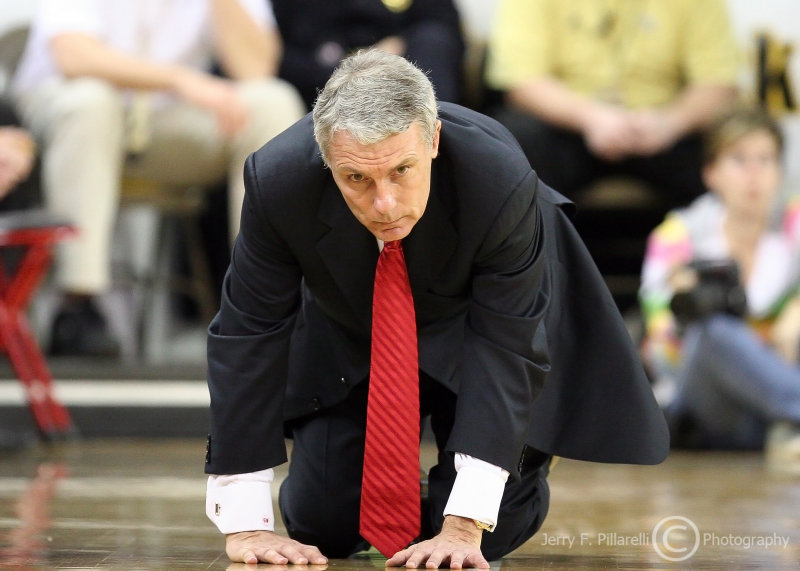 Maryland Terrapins Head Coach Gary Williams collapses to the floor to show his dismay over the play of his team