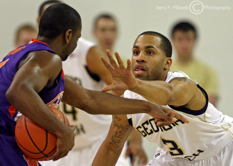 Yellow Jackets G Miller squares up on a Tigers ball handler