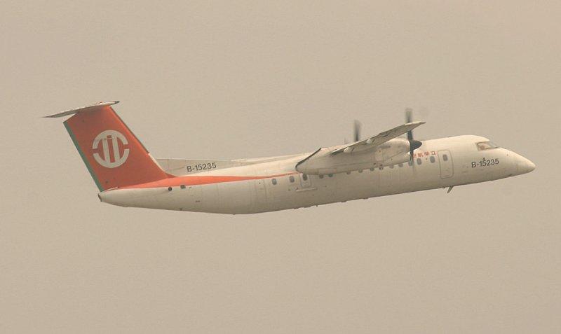 UNI Air Dash-8 taking off from Song Shan Airport, Taipei (TSA)