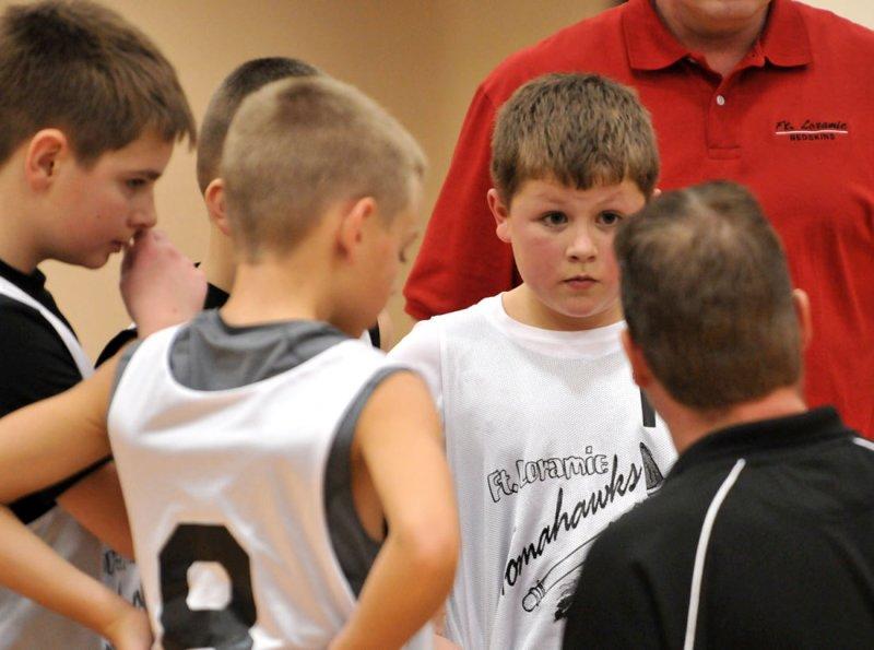 Nolan listening to the coach