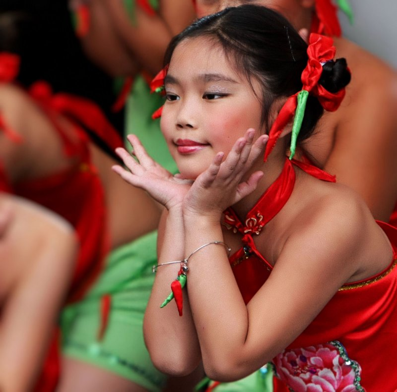Red and green chilli pepper dance of a chinese children dance group
