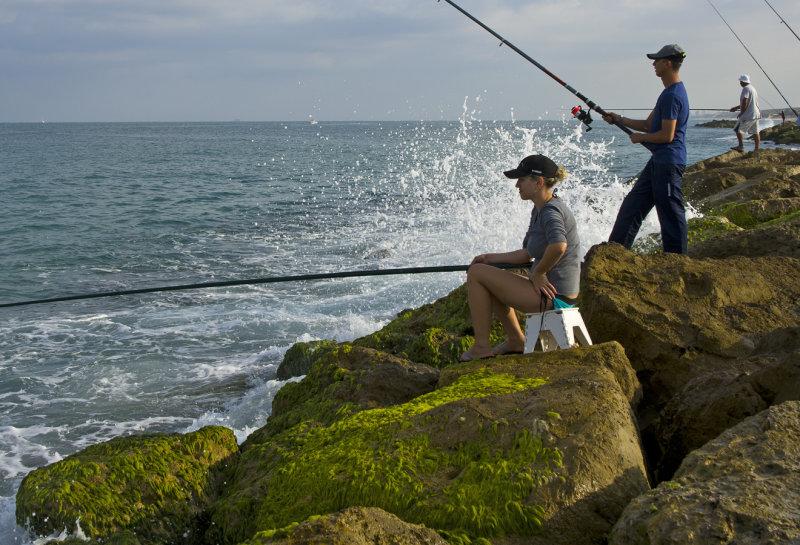 Anglers on breakwater