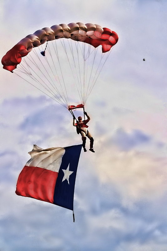 PARACHUTING THE TEXAS FLAG