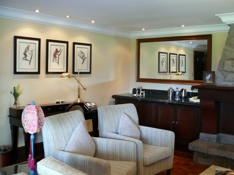 The other part of the sitting room with the bar & coffee maker