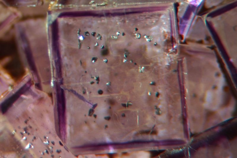 Seata fluorite colour-banding and sulphide inclusions. The cubes have beautiful trapezohedral modifications to the corners.