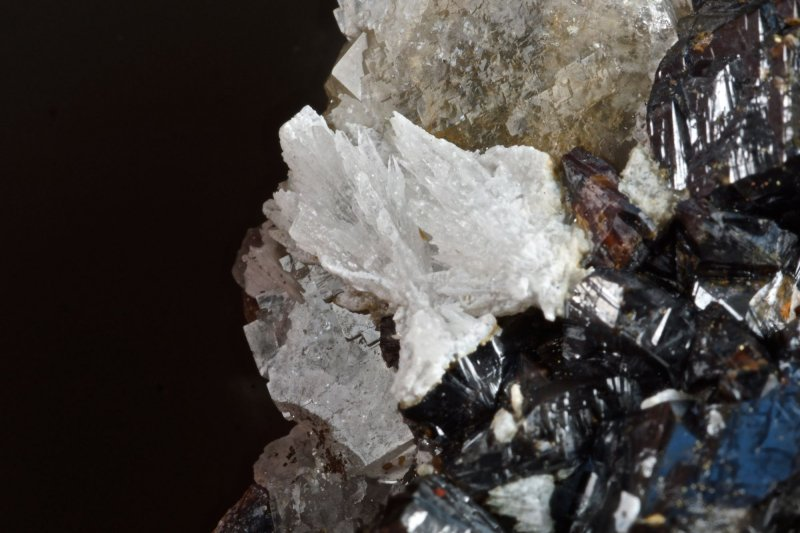 Strontianite crystals on fluorite with sphalerite, cerussite and chalcopyrite. Old Gang Mines, Reeth, Swaledale, N Yorkshire.