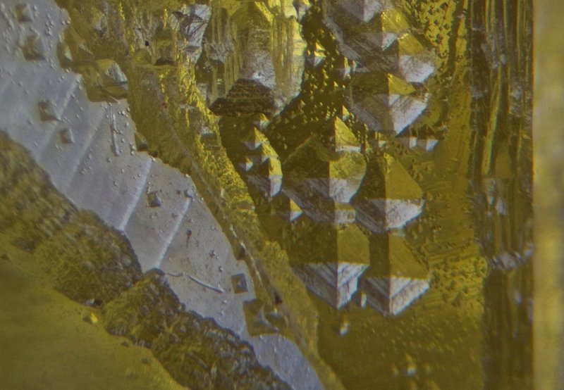 Detail of octahedral etch pits in Hilton Mine fluorite.