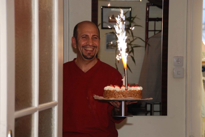 And here comes dad with my cake,