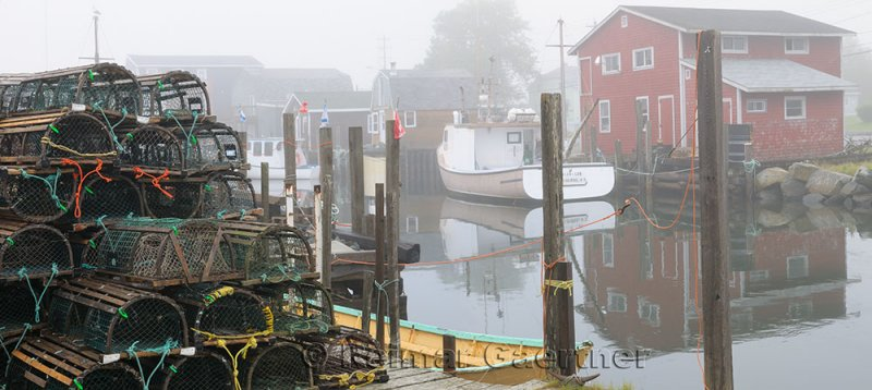 Lobster traps and boats in fog at Fishermans Cove Eastern Passage Halifax Nova Scotia