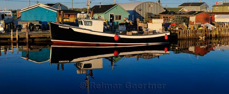 Sunrise with tour boat at Fishermans Cove Eastern Passage Halifax Nova Scotia