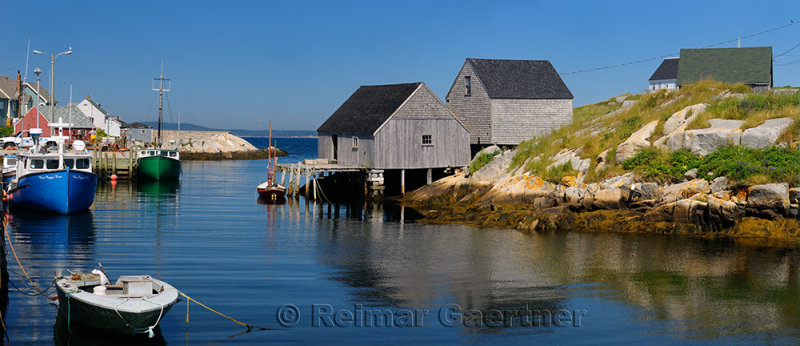Peggys Cove off of St Margarets Bay Nova Scotia with fishing village houses and boats