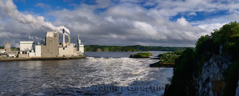 Panorama of Reversing Falls and pulp mill in Saint John New Brunswick at Bay of Fundy low tide