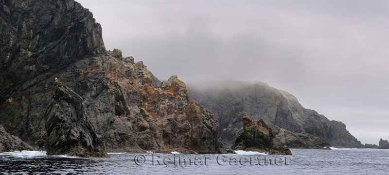 Panorama of rough cliff and spires at Devil`s Cove Head and Long Point Lighthouse Twillingate Newfoundland