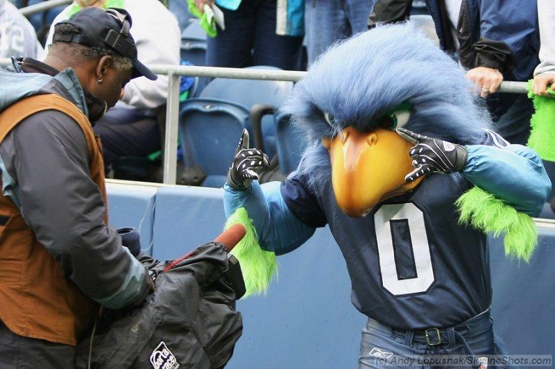 Seattle Seahawks mascot Blitz with CBS Sports cameraman Larry Frazier