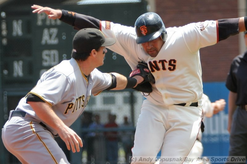 Pittsburgh Pirates 3B Andy LaRoche tags out San Francisco Giants catcher Bengie Molina