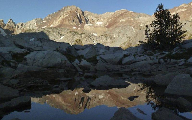 Early morning light over an alpine tarn.