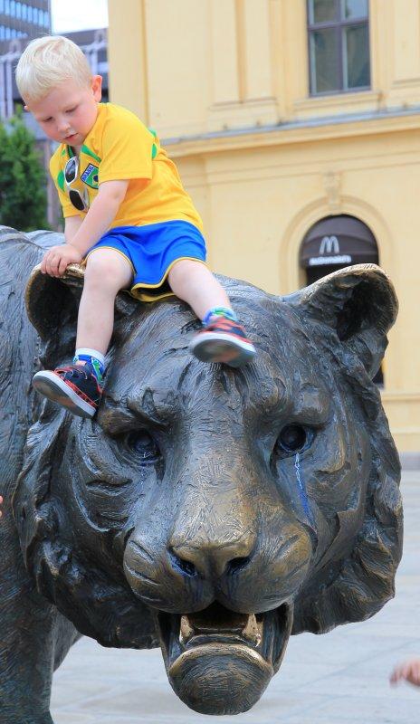 Boy riding the Oslo Tiger