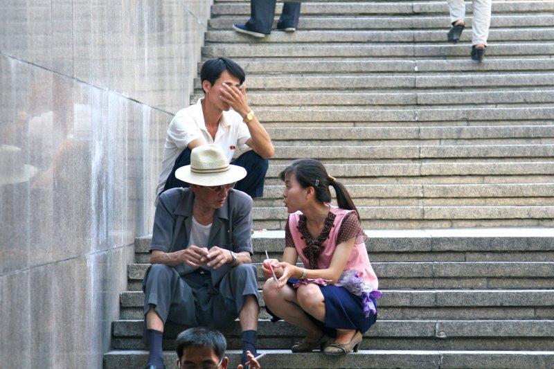 Sitting outside the Pyongyang Metro