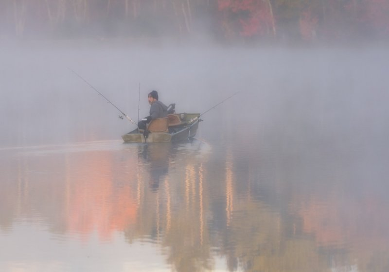 Fishing in  the early morning  mist
