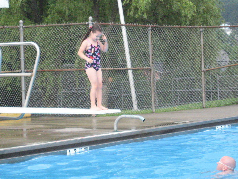 Leila contemplating jumping off the board