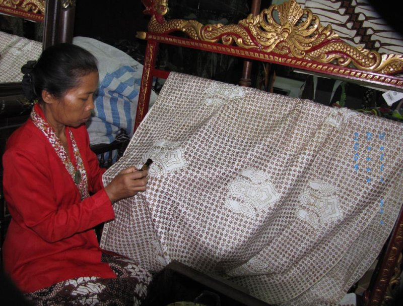Woman Demonstrating Batik Design