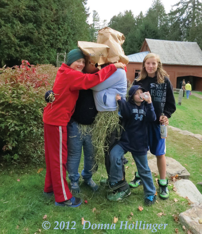 Hugging two Scarecrows