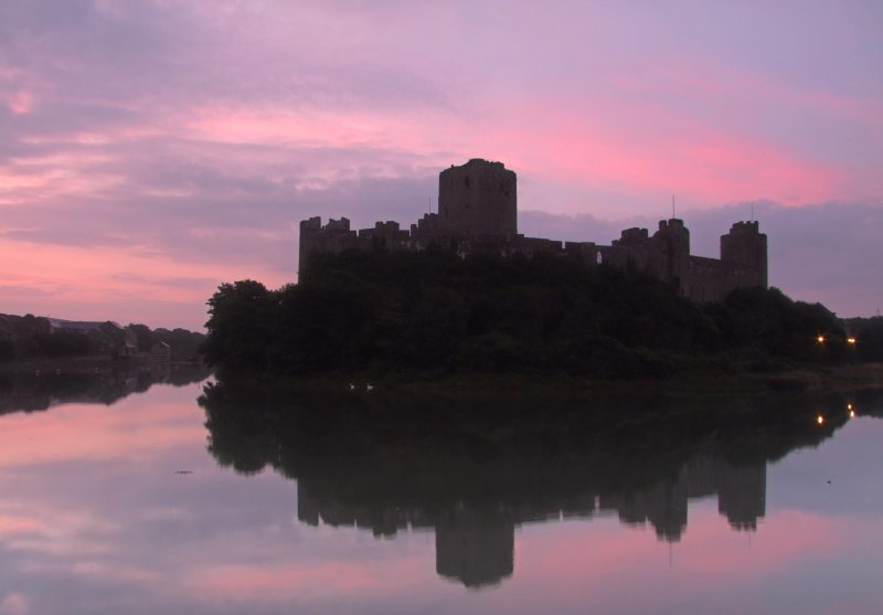 The  dawn  arrives  over  Pembroke  Castle.