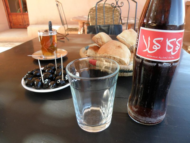 a typical midday snack: mint tea, bread, olives, and a Coke