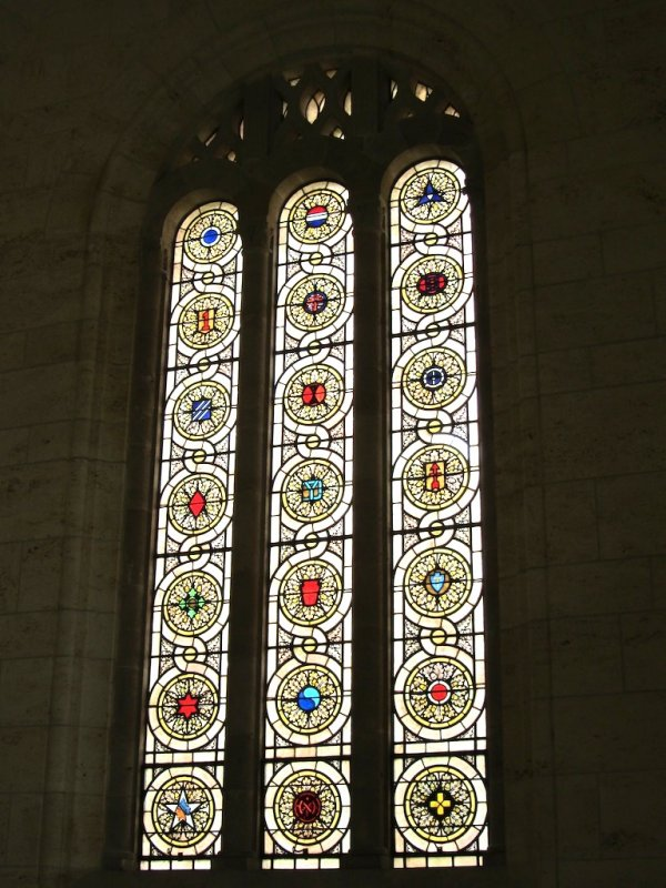stained glass windows include the insignia of the divisions (the 29th is at center, second row from the bottom)
