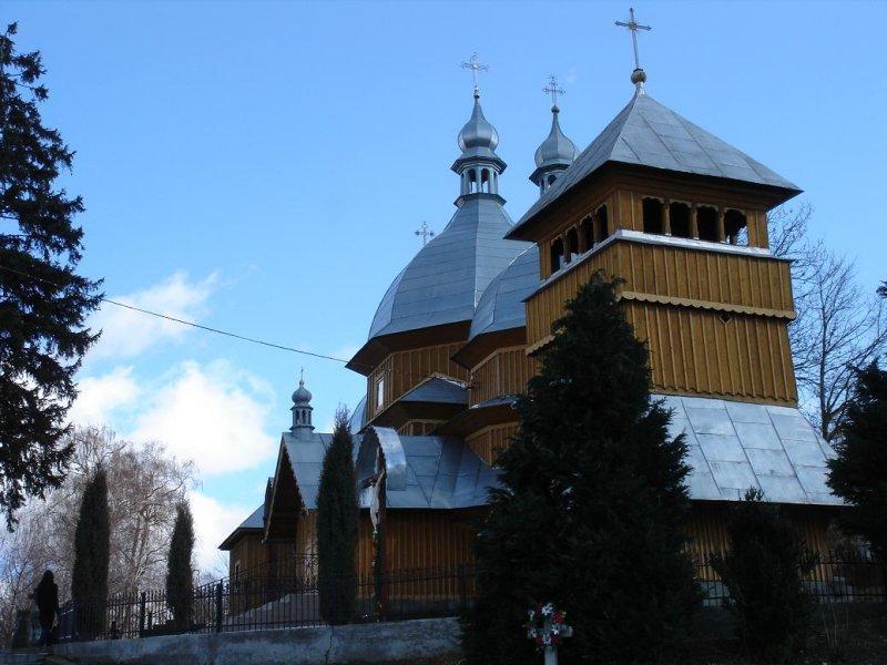 wooden St. Nicholas church, above town