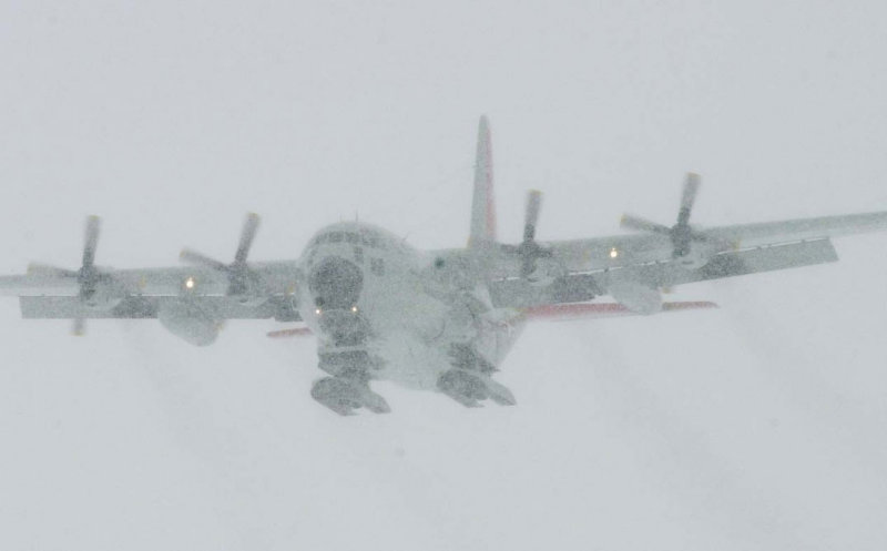 An  ski-equipped LC-130 lands near McMurdo station